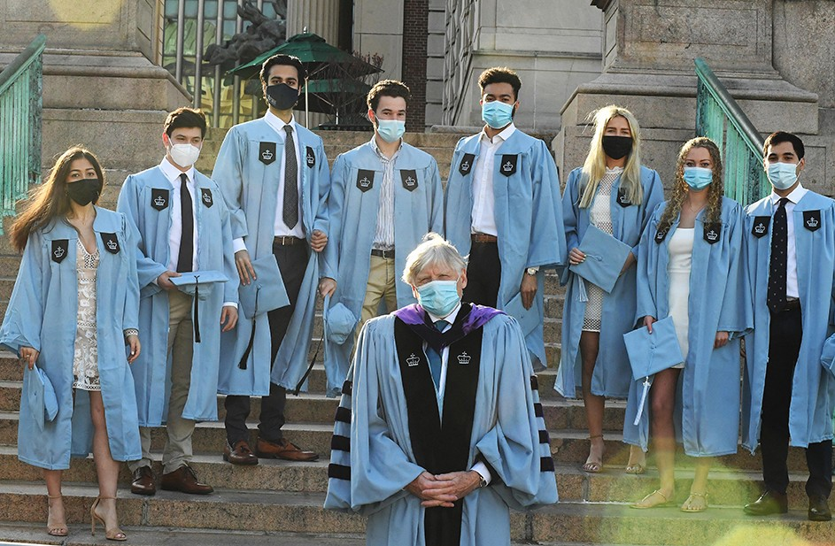 Columbia President Lee Bollinger poses with several grads on Low Steps.