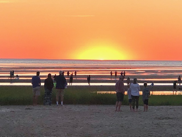 The sun rises over Cape Code beach and the Atlantic ocean.