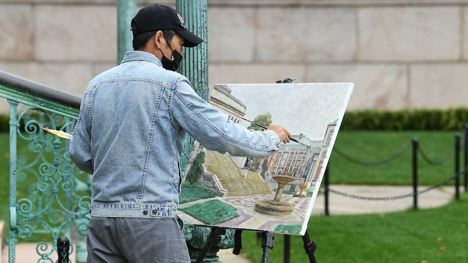 Painter by the steps of Low Library at Columbia University