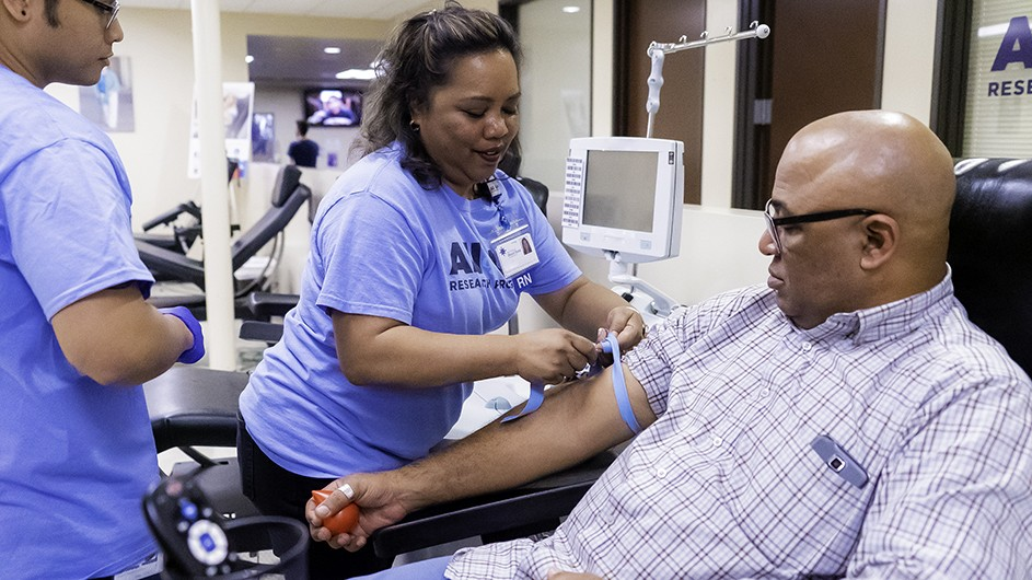 A participant has his blood drawn to enroll in the All of Us Research program, a National Institute of Health initiative that aims to create a more diverse genetic databank.