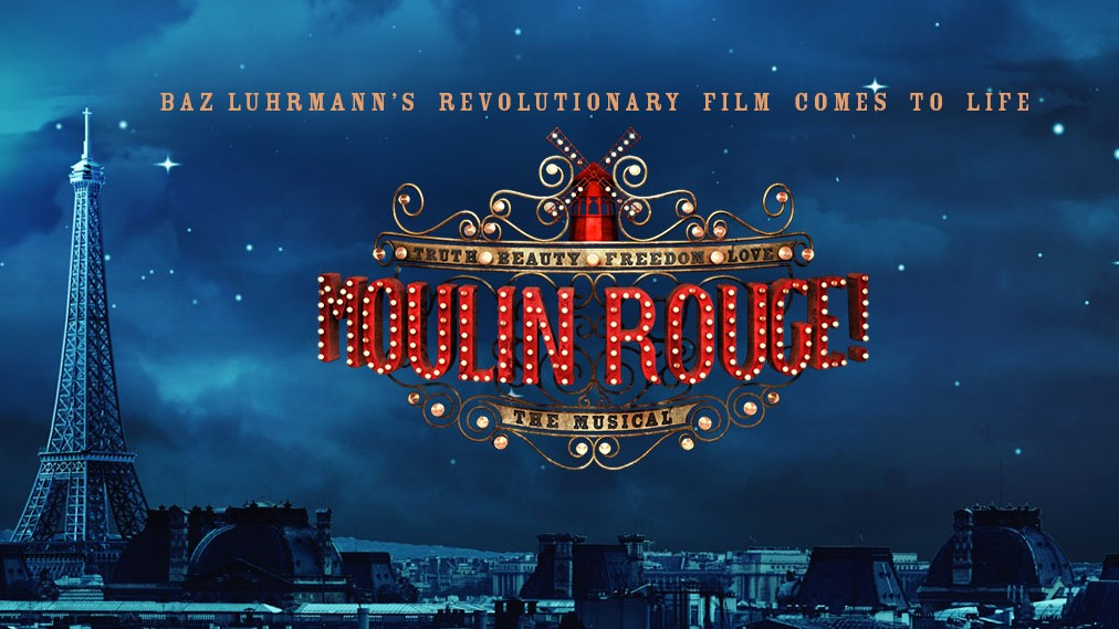 A night scene of Paris with Moulin Rouge script in the sky.