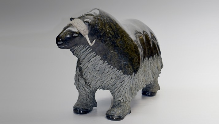 Small soapstone and antler statue of a muskox