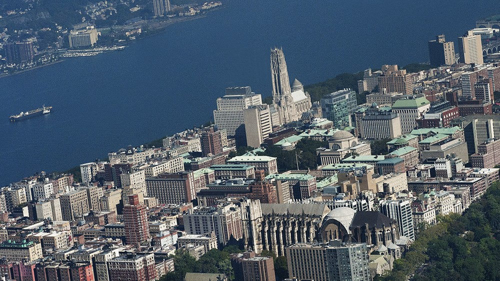 A birds-eye view of a slice of Manhattan buildings, the Hudson River and a slive of New Jersey.