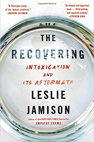 "Book cover for The Recovering, featuring the words ""The Recovering: Intoxication and Its Aftermath"" viewed through an alcohol tumbler"