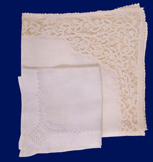 Two white handkerchiefs on blue background
