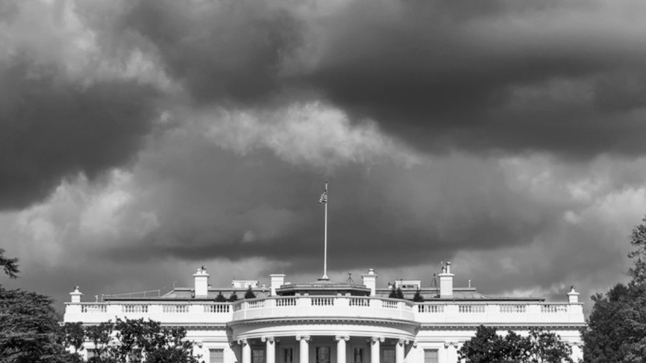 Black and white photo of dark clouds over the White house