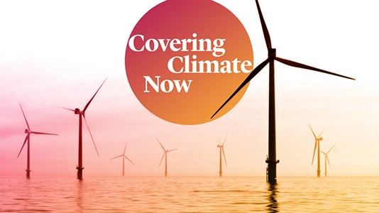 "Image of wind turbines with the caption ""Covering Climate Now"""