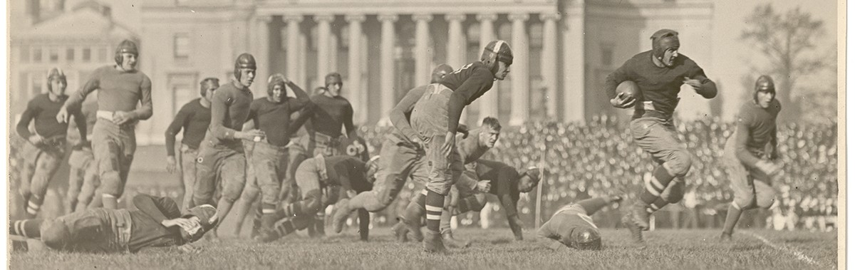 An archival photo of the Columbia Lions Football team in the early 1900s playing on a field in front of Low Library.