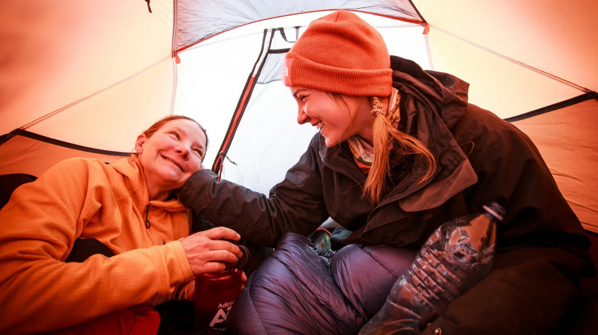Isabella, left, and Bella shared a moment in their tent at Camp 1 along their climb up Aconcagua. Photo by Max Whittaker for The New York Times