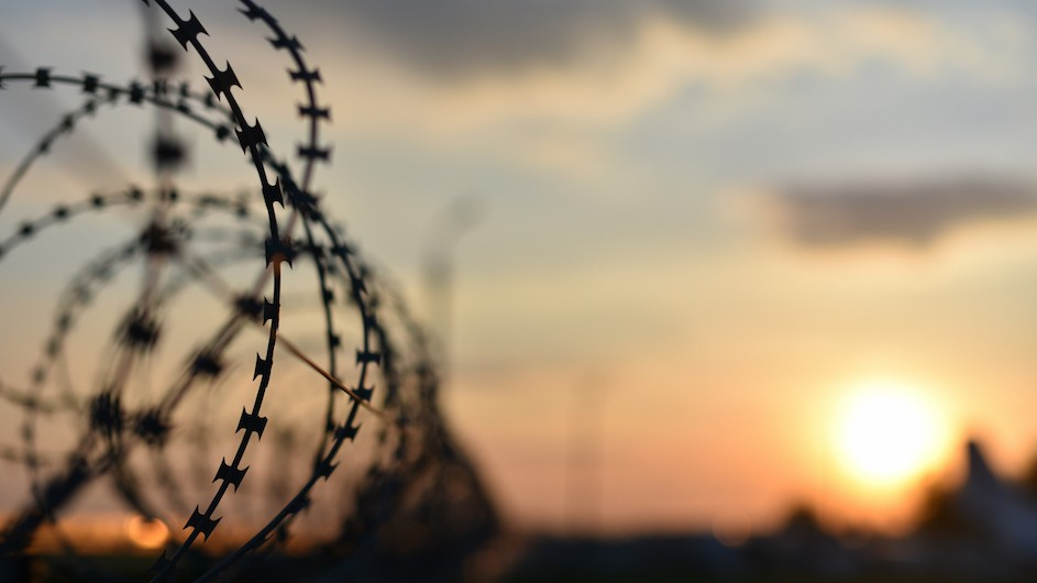 An image of barbed wire and the sunset