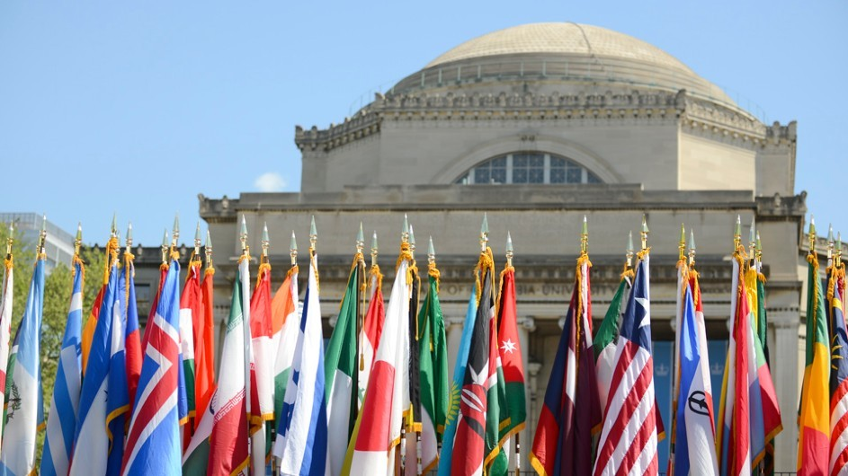 International flags on flag poles in front of Low Library, a domed building