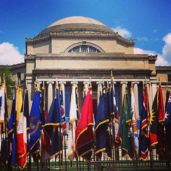Photo of a number of international flags outside Low Library at Columbia University