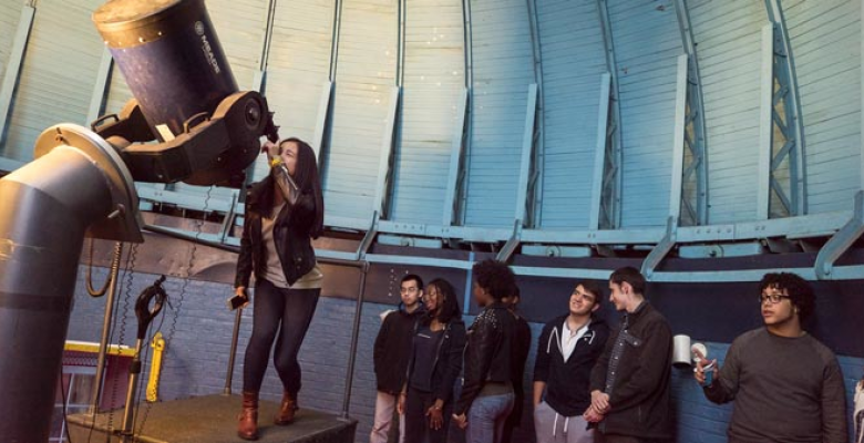 Students looking through a telescope