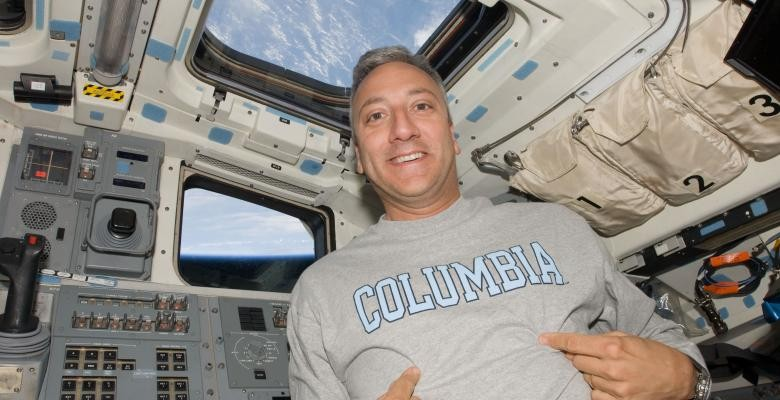 Mike Massimino in a space shuttle
