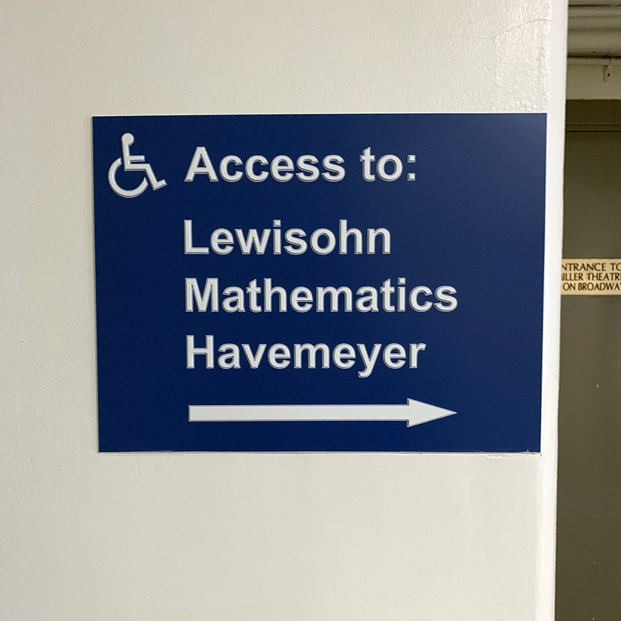 A sign points to disability access ramps to the buildings Lewisohn, Mathematics, and Havemeyer.