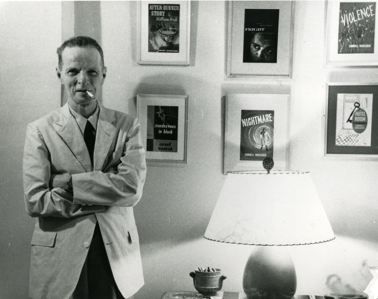 Cornell Woolrich in Hotel Franconia by a wall filled with his movie posters.