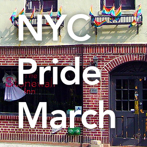 The Stonewall Inn red brick storefront with two windows on top surrounded by small rainbow flags.