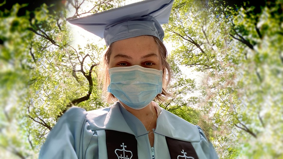 Orla Tinsley: A woman in Columbia blue cap and gown and face mask.
