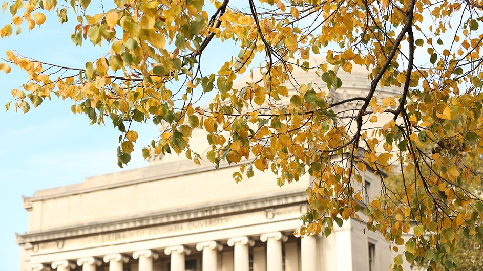 Fall foliage against the backdrop of Low Library, on a clear day.