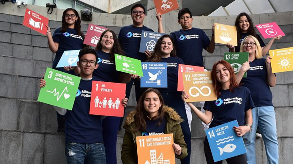 UN Millennium Fellows: A group of students hold signs that highlight various climate change issues