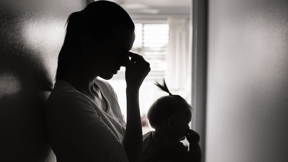 A black and white photo of a mother and baby in silhouette