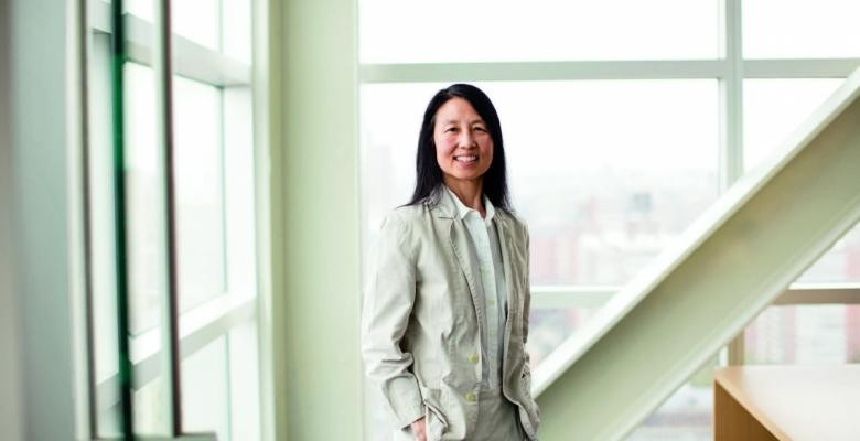 Jeannette Wing in a beige suit, in a white, well-lit room