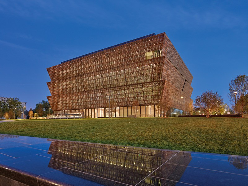 The National Museum of African American History and Culture lit up at night