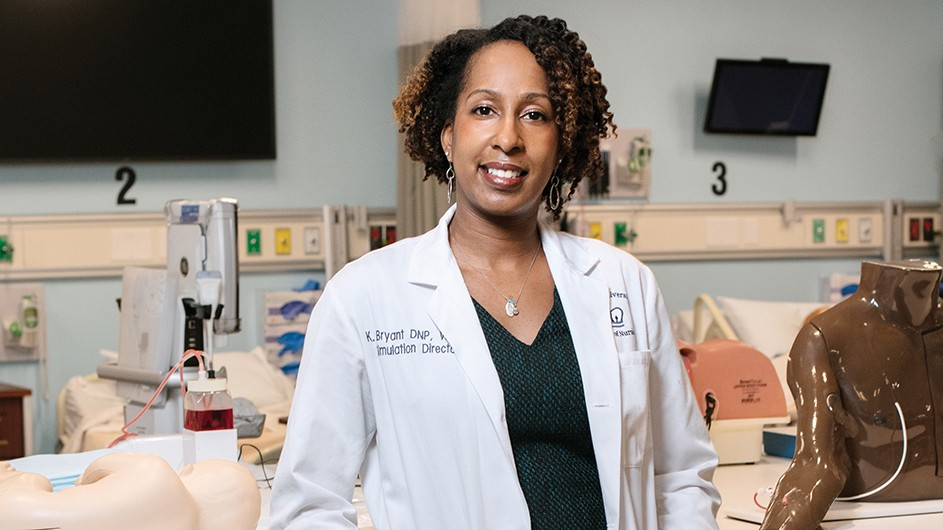 Black woman with dark curly hair in lab coat