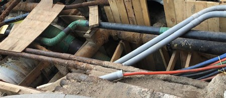 grey and green pipes on construction site with brown wood plants