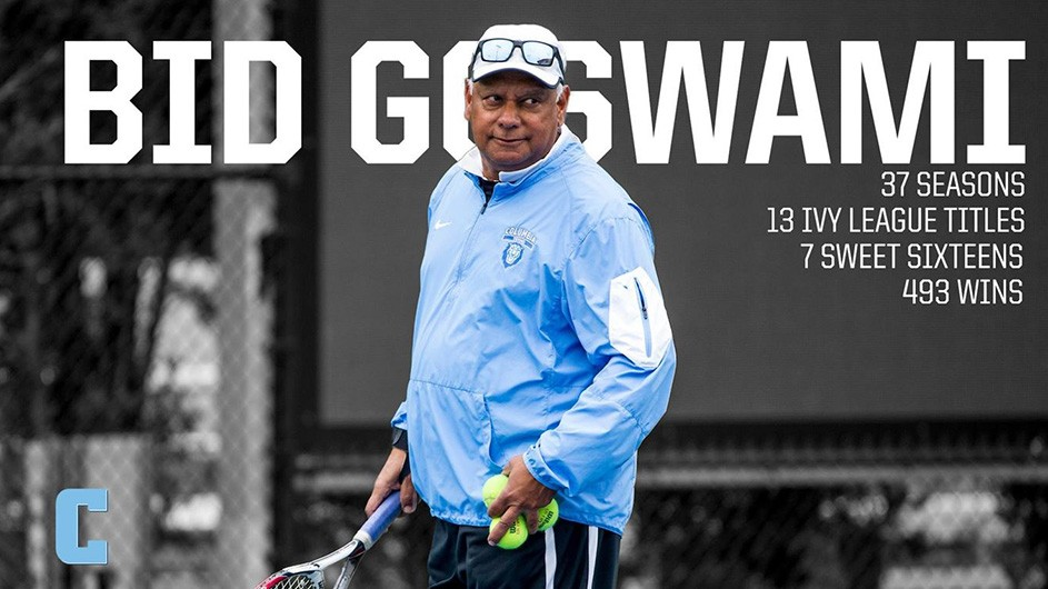 Bid Goswami, the Columbia Tennis Coach, in a light blue windbreaker jacket, holding a tennis racket and three yellow tennis balls.