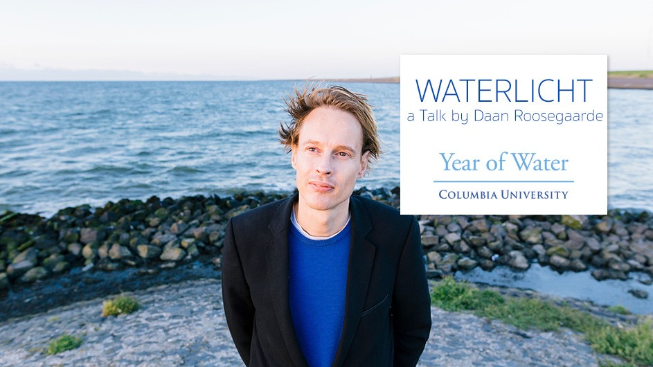 Daan Roosegaarde in a blue shirt and blazer standing in front of the ocean.