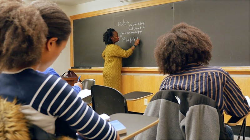 Farah Jasmine Griffin writing on a chalkboard in a black history course.