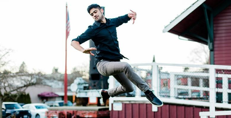 Image of Vikas Arun dancing atop of a building