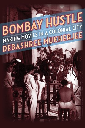 A book cover with text and a photo of people on a film set.