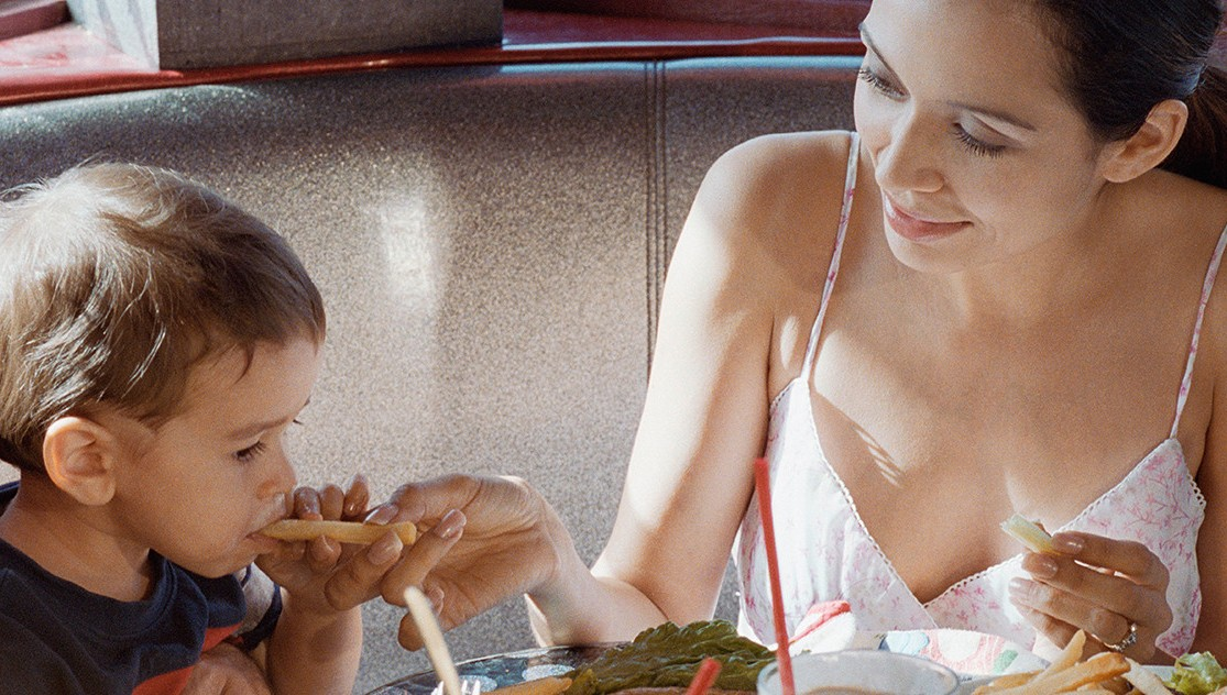 Mother and toddler in restaurant