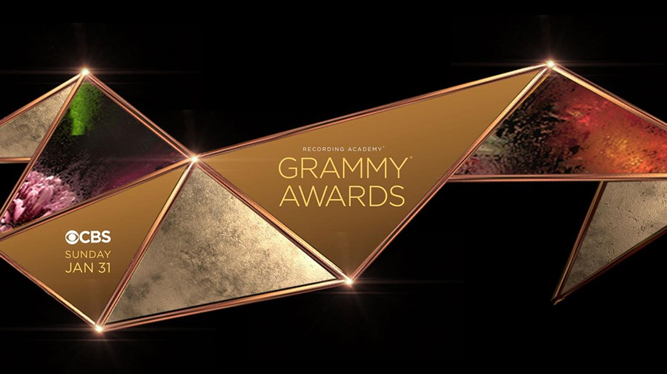 An image of a gold design announcing the Grammy Awards.