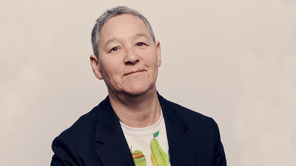 Jack Halberstam: smiling and wearing a printed T-shirt under a dark jacket.