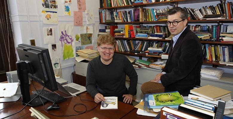 matthew jones and chris wiggins seated in an office surrounded by books