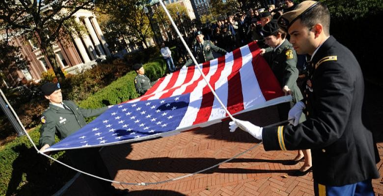 Veterans folding flag at ceremony on Morningside campus